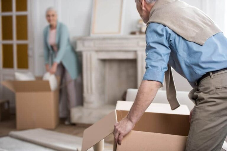 senior-couple-packing-up-cardboxes-in-home