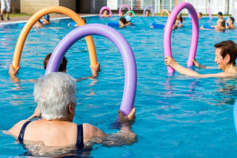 Senior-doing-water-aerobics-with-pool-noodles